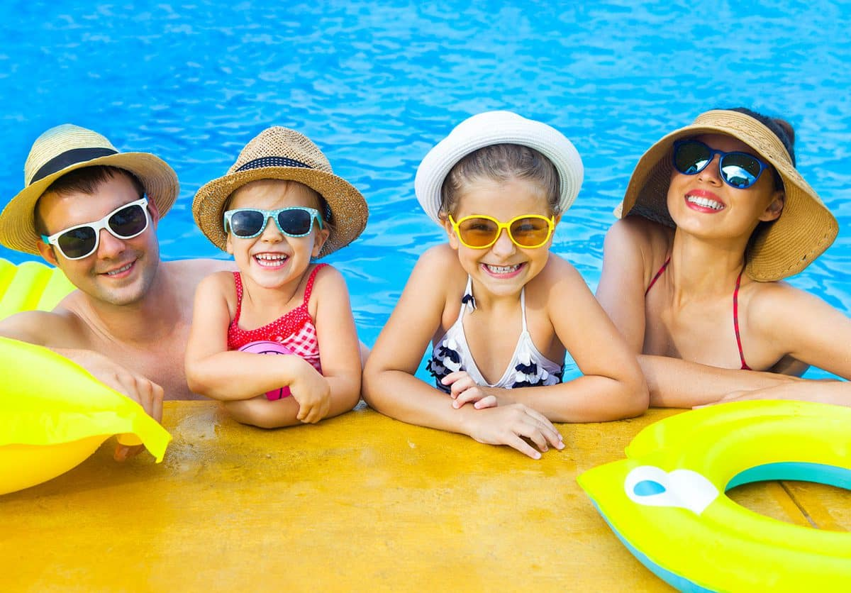 family by swimming pool
